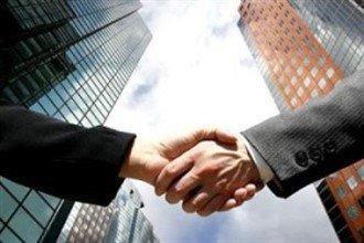 Рукпожатие партнеров по бизнесу